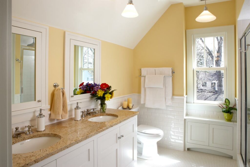 bathroom yellow walls white subway and hex tile